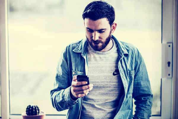 guy checking on phone alone