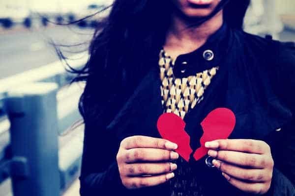 black-lady-holding-a-broken-heart