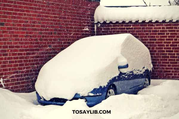 heavy snowfall on a car