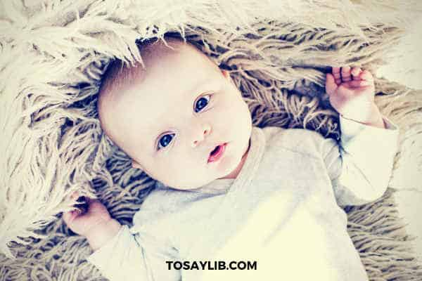 lovely baby laying on a carpet