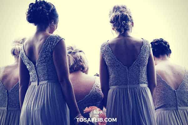 bridesmaid in purple gowns shot from their back