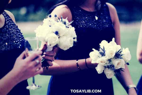 bridesmaid bouquets of white flowers champagne