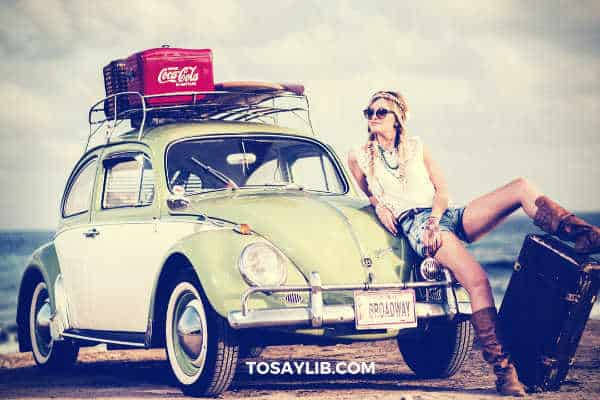 girl bohemian going on trip by car