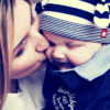 mother kissing baby boy cute blue