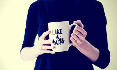 staff holding a mug like a boss