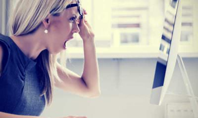 woman-astonished-annoyed-at-imac-screen