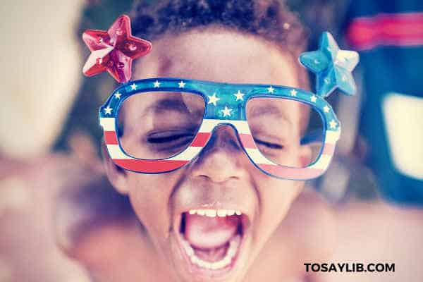 kid wearing amercian flag glasses