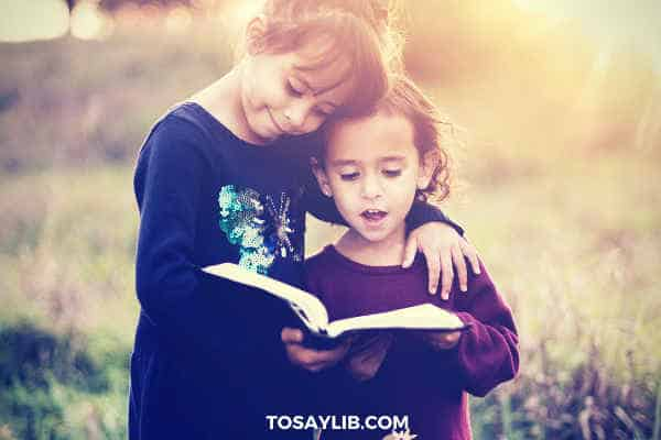 two little girls reading books