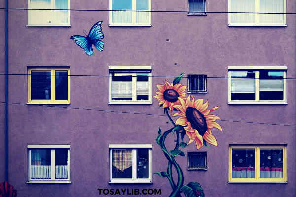 butterful sunflower paintings on a building