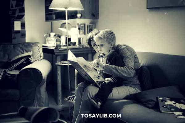 mother teaching son how to read