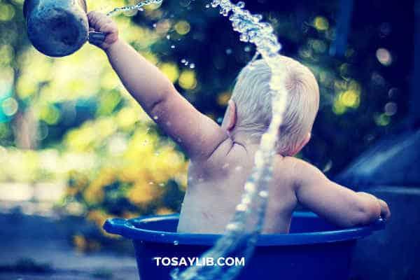 baby splashing water