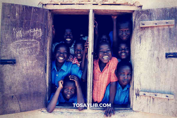 students happily smiling window school