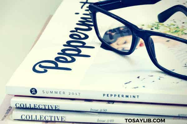 fashion magazine black framed glasses