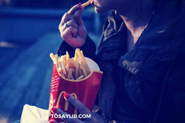 girl eating french fries macdonald