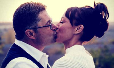 husband-kissing-wife-celebrate-wedding-anniversary