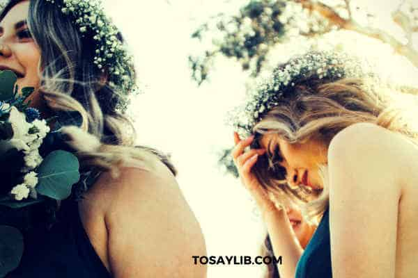 bridesmaid touching her head thinking