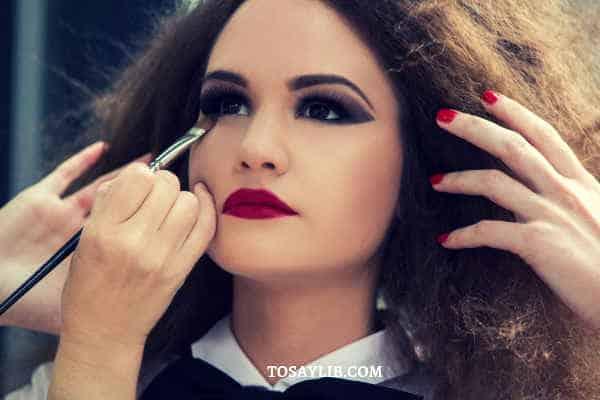 makeup artists doing makeup for a gir