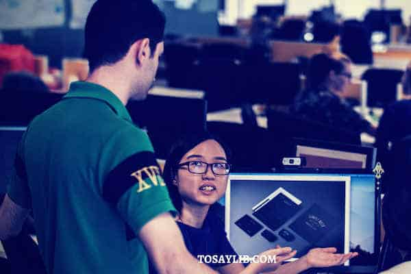 chinese girl explaining to white boss workplace