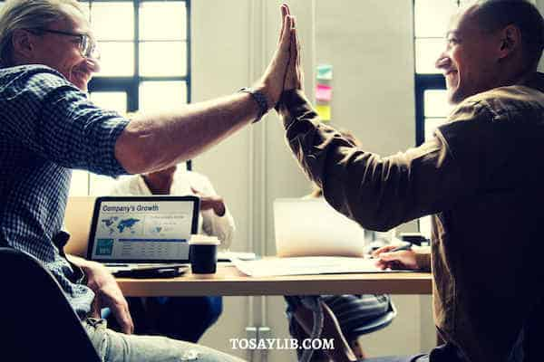 workplace colleagues high five