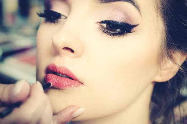 make-up-artist-applying-lipstick-on-a-model
