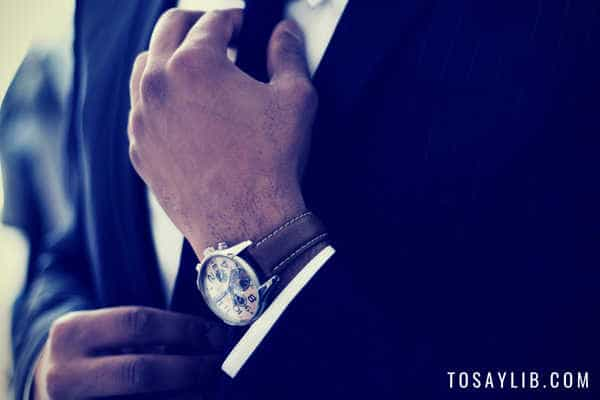 man in black suit wear watch