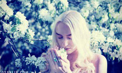 pretty-blonde-smelling-flowers