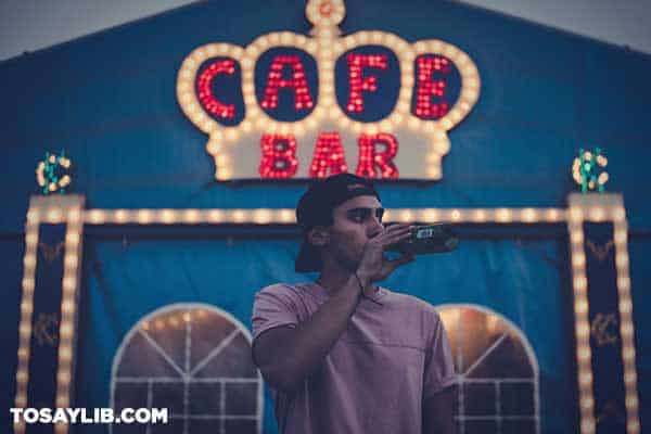 07 Man standing outside a bar drinking beer
