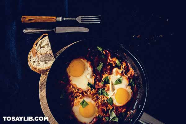 19 Three fried eggs on a fiery pan