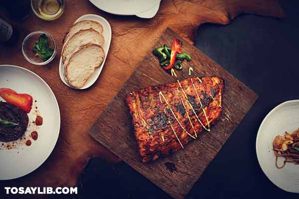 25 Flat lay photo of grilled meat beside bread and vegetables