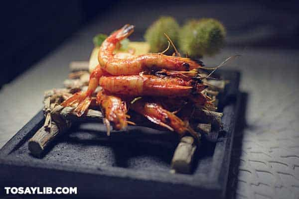37 Cooked prawns on bamboo stick