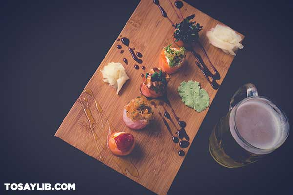 46 Well presented sushi board with a clear beer mug