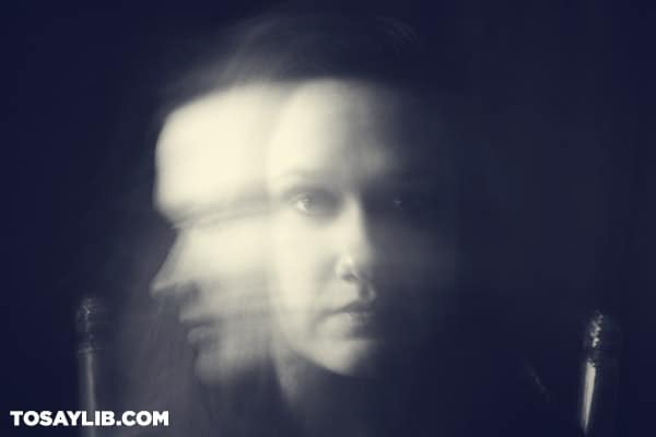 19 Black and white photo of a lady with blurry face