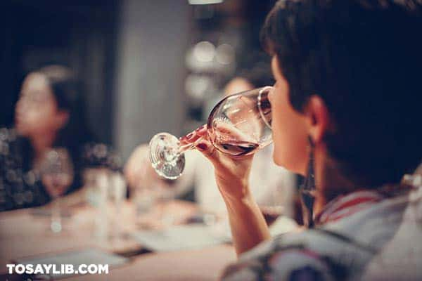 04 person sipping wine