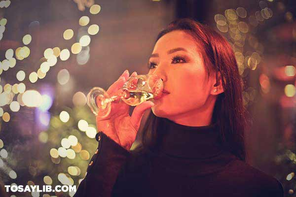 16 Woman sipping white wine