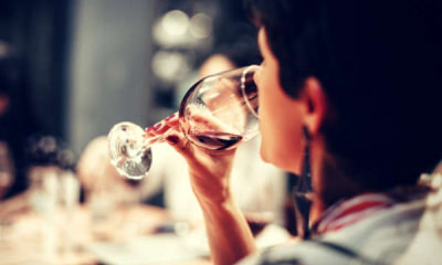 Feature-person-sipping-wine