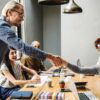 05-Feature-newcomer-shaking-hands-and-thanking-his-colleagues-in-the-same-team
