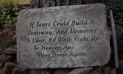 06-featured-A-photo-of-a-written-eulogy-carved-on-a-piece-of-concrete