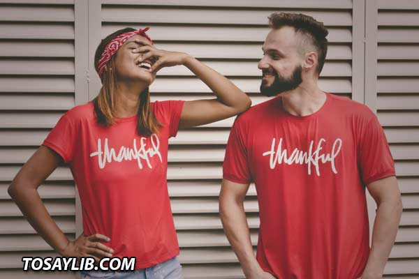 Photo of a couple wearing red shirts that says Thankful