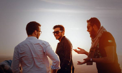 10-Featured-Photo-of-three-men-standing-and-laughing-together