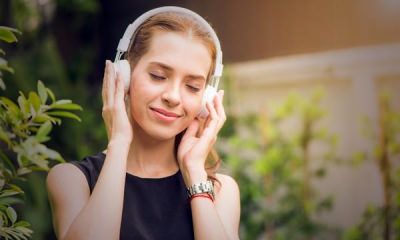 14-Featured-Woman-calmly-listening-to-music-from-her-headset