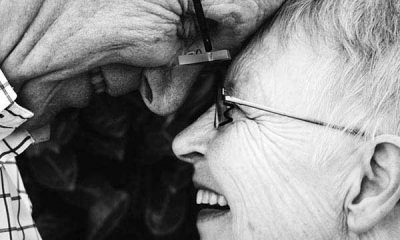 61featured-Oldcouple-with-faces-so-close-to-each-other-and-smiling