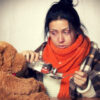 12-feature-woman-in-sweater-blanket-sick-taking-medicine-teddy-bear-table-gray-background