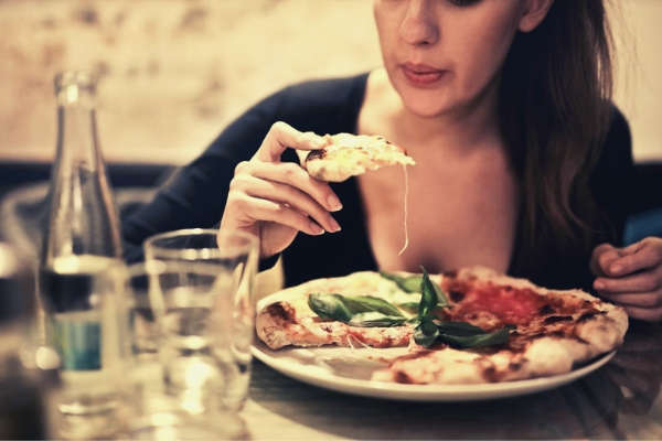 22-feature-girl-blowing-sliced-pizza