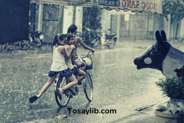 children happy playing under the rain