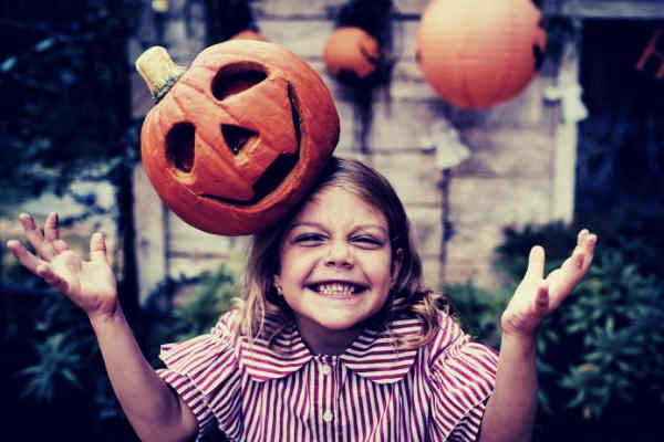 03-feature-orange-pumpkin-on-girl-s-head-halloween