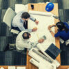 04-feature-three-people-sitting-beside-table-working-on-architect-blueprint-business