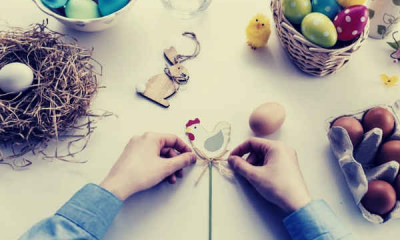 07-feature-person-tying-knot-on-chicken-decor-eggs-basket-wooden-rabbit-chick-white-table