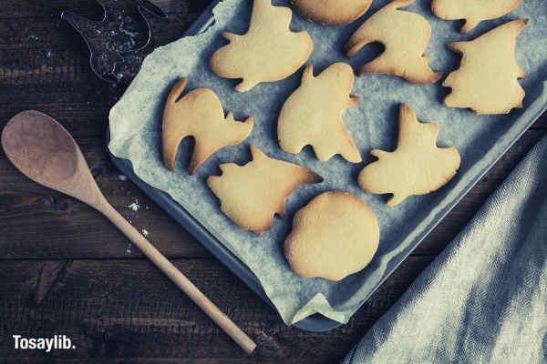 halloween cookies on cookie tray wooden spoon wood
