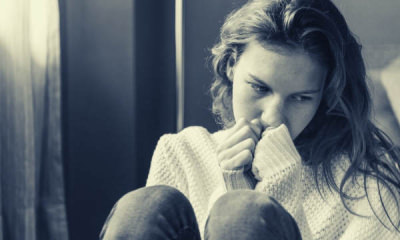 feature-grayscale-photo-of-woman-covering-her-mouth-using-her-hands