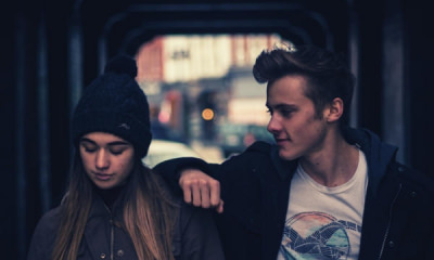 feature-young-couple-in-the-city-at-night-walking